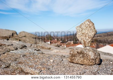 Balanced stones stack with blue sky background
