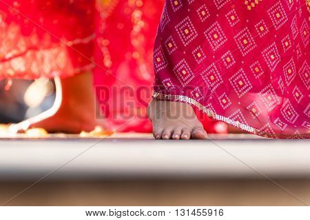 Bare feet of indian female dancer on the stage