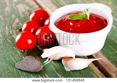 Tomatoes With Garlic And Ketchup On Green Board