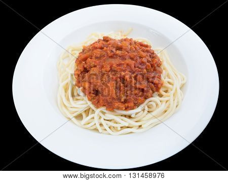 Spaghetti bolognese with pork or meat tomato sauce on a plate isolated on the black background with clipping path