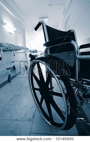 Medical theme: a wheel chair in a hospital.