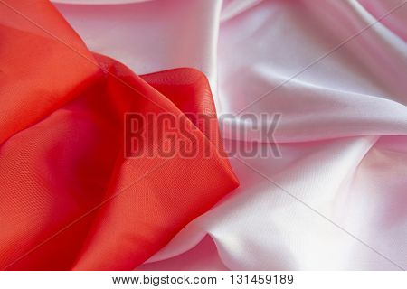 Shiny Pink and Red silky fabric folds background texture