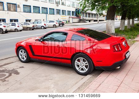 SAMARA RUSSIA - MAY 21 2016: Ford Mustang parked up at the city street in summer day. The Ford Mustang is an American automobile manufactured by Ford