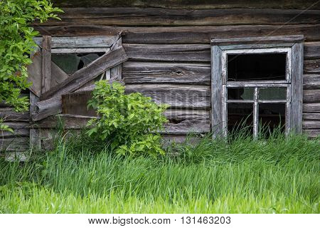 Old Wooden gloomy Cabin in the village
