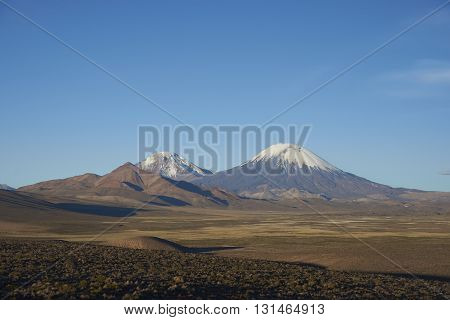 Snow and ice covered peak of the volcano Parinacota (6342m) on the altiplano in Lauca National Park, northern Chile.