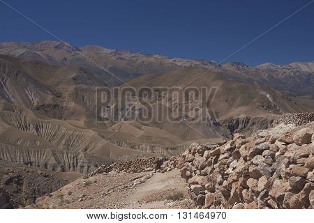 Archeological site with remains of the historic fortress of Pukara de Copaquilla in the Andes Mountains of northern Chile.