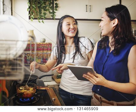 Sisters Happiness Cooking Activity Concept