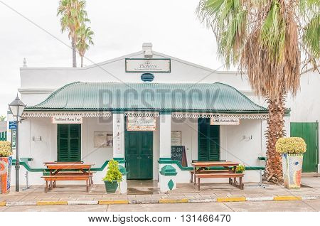 GRAAFF REINET SOUTH AFRICA - MARCH 7 2016: A restaurant in a historic house in Graaff Reinet. The building is a national monument