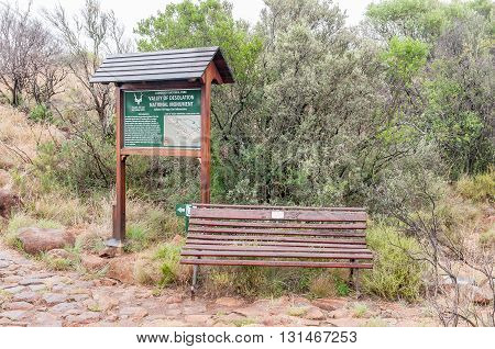 GRAAFF REINET SOUTH AFRICA - MARCH 7 2016: An information board and bench at the start of the Crag Lizard trail near the Valley of Desolation viewpoint