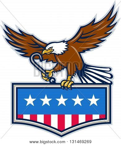 Illustration of an american bald eagle holding towing j hook and clutching american usa flag inside shield crest with its talon set on isolated white background done in retro style.