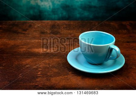 Empty Cup Of Coffee And Rust Background.