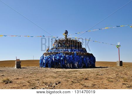 The Aobao in Xilamouren Grassland in Inner Mongolia. the Mongolian people in Inner Mongolia use Aobao for sacrifice and pray for good weather harvest and fortune. Aobao means heaps of stones.
