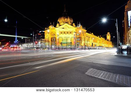 MELBOURNE AUSTRALIA - OCTOBER 24: Night scene of Flinders street station on October 24 2015. Its the busiest station on Melbourne's metropolitan network and one of the iconic landmark in Melbourne.