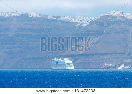 Santorini Island and the village Imerovigli on the slopes of the volcano. Greece.