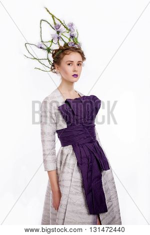 Shot of beautiful young woman in Japanese fashion elegant designer purple dress with crown on white blackground