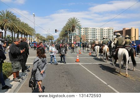 ANAHEIM CALIFORNIA, May 25, 2016: Protesters scramble out of the way as Equestrian police on horse back separate and move the away at the Presidential Candidate Donald J. Trump rally 5.25.2016