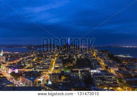 San Francisco, California, USA - April 23, 2016 - Coit Tower, San Francisco Bay and the North Beach community at dusk.