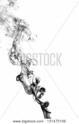 Black smoke on white background from the incense sticks