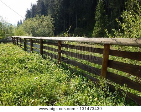 Traditional wooden fence boards in rural areas