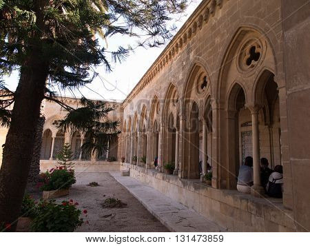 JERUSALEM ISRAEL - JULY 13 2015: The gothic corridor of atrium in Church of the Pater Noster on Mount of Olives. Israel