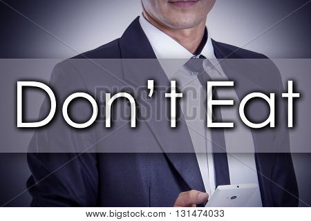 Don't Eat - Young Businessman With Text - Business Concept