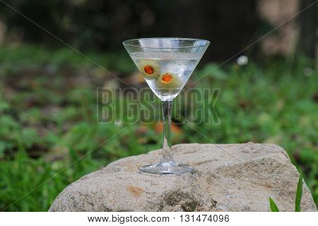 Classic dry martini straight up with two olives