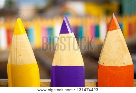 colorful fence of a kindergarten. wooden fence of colored pencils.