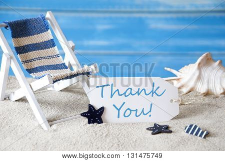 Summer Label With English Text Thank You. Blue Wooden Background. Card With Holiday Greetings. Beach Vacation Symbolized By Sand, Deck Chair And Shell.
