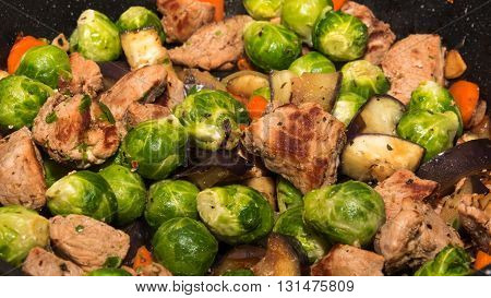 Pork fried with brussel sprout, carrot, onion and eggplant