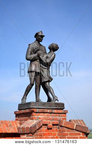 Statue of lancer soldier dancing with girl in Grudziadz in northern Poland