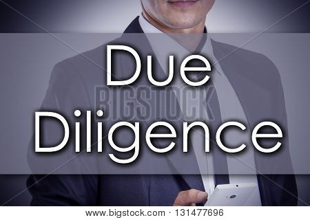 Due Diligence - Young Businessman With Text - Business Concept