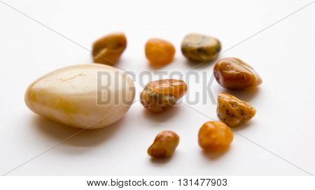 white colors background, stones,brown and yellow colors