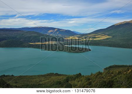 Lake on the south Island of New Zealand. Turquoise Lake Rotoiti. St Arnaud small village. View from Mt Robert.