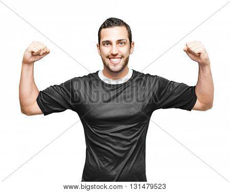 Athlete wearing black uniform celebrating on white background