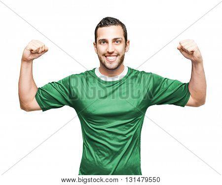 Athlete wearing green uniform celebrating on white background