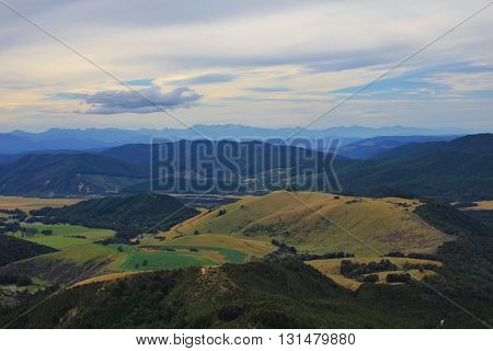 Hills and mountain ranges in New Zealand. View from Mt Robert. Evening scene.