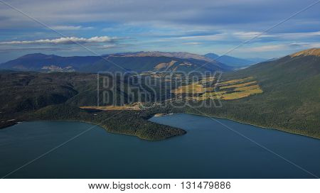 Landscape in New Zealand. Lake Rotoiti. Small village St Arnaud. Hills and mountains in summer.