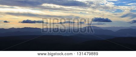 View from Mt Robert New Zealand. Sunset over the Southern Alps. Many mountain ranges and valleys.
