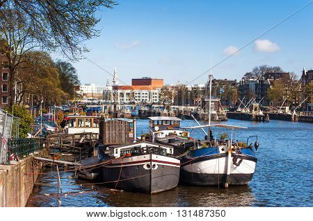 Moored boats at Amsterdam canal in spring time.
