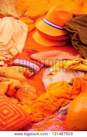 Orange clothing display at Amsterdam street market in Kings day celebration.