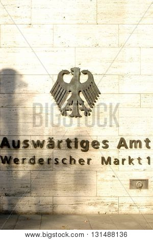 BERLIN, GERMANY - MAY 10: The entrance of the Foreign Office in Berlin's government district with a logo and the federal eagle on the facade on May 10, 2016 in Berlin.