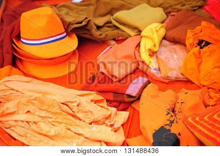 Abstract composition of orange clothing in Amsredam street market at Kings day