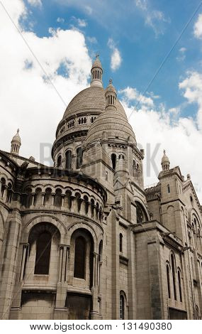 The basilica Sacre Coeur is a Roman catholic church located at the summit of the butte Montmartre the highest point in Paris.