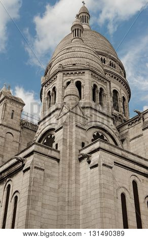 The basilic Sacre Coeur is a Roman catholic church located at the summit of the butte Montmartre the highest point in Paris.