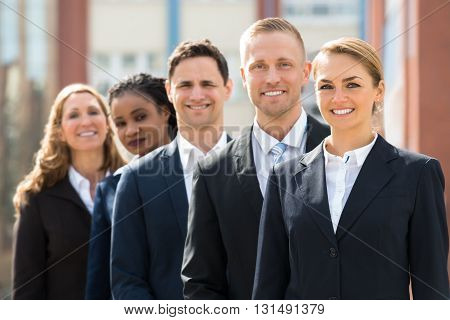 Team Of Professional Businesspeople Standing In Queue Outdoor