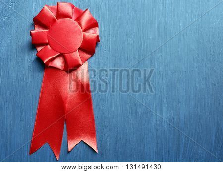 Award ribbon on wooden background