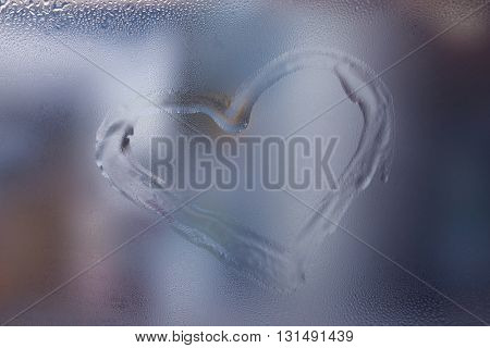 Heart drawn on the fogged glass window