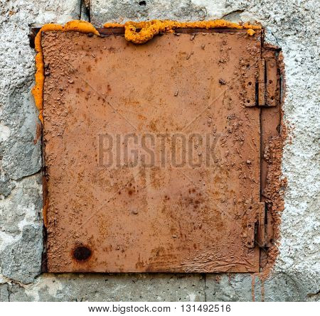 An Old Rusty Hatch on The Wall