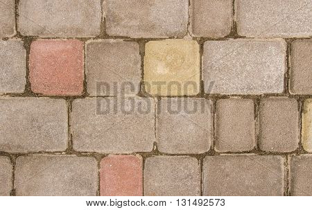 Old paving-stone gray pink and yellow. close-up on top of natural light.