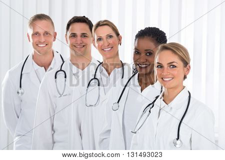 Team Of Happy Medical Practitioner Standing In A Line